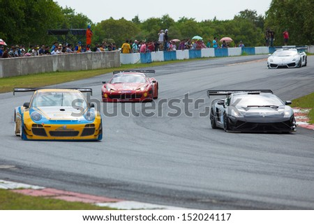PATTYA, THAILAND-AUG.18 : Group of racing car in Super car class1 round 4 during the Thailand Super Series 2013 Round 3-4 at Bira International Circuit on August 18, 2013 in Pattaya, Thailand.