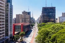 Paulista avenue, financial center of Sao Paulo and Brazil and MASP seen from above with its commercial buildings and intense movement of people and cars