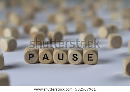 pause - cube with letters, sign with wooden cubes