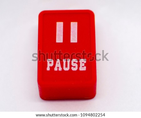 Pause text on red button symbol or sign