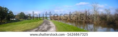 Paved bike path on top of earthen dike levee along Mississippi River in Louisiana  Stock fotó ©