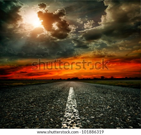 paved road at sunset
