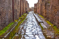 Paved street at the ancient Roman city of Pompei, Italy. Pompei was destroyed and buried during the eruption of Mount Vesuvius in 79 AD