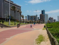 Paved walkway lined with hotels at durban beachfront, south africa