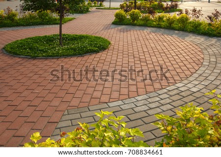 paved with tiles path in the Park