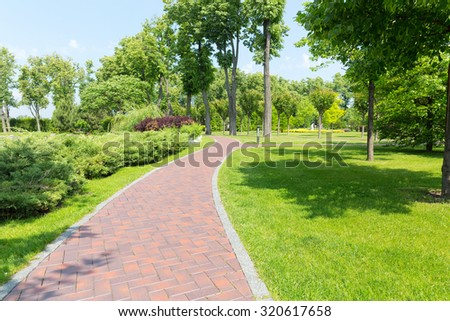 Pavement in the park - Shutterstock ID 320617658