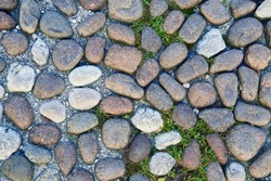 Pavement pebble pathway pattern texture background, the part of italian old style stone sidewalk