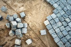 Pavement rocks, stones and cobblestone blocks, construction of path, road or sidewalk