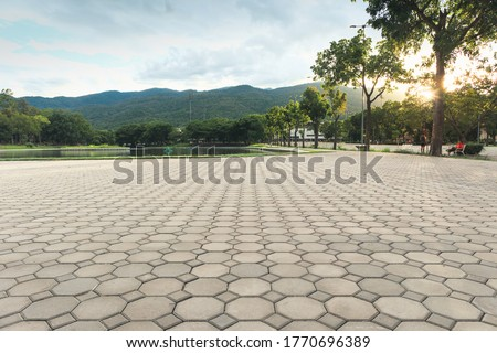 Paver brick floor also call brick paving, paving stone or block paving. Manufactured from concrete or stone for road, path, driveway and patio. Empty floor in perspective view for texture background.