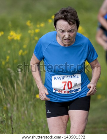 PAVIE, FRANCE - JUNE 23: Elderly female runner at the Trail of Pavie, on June 23, 2013, in Pavie, France.