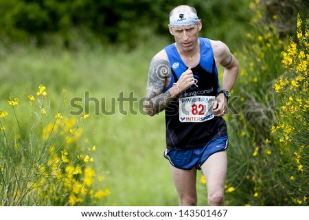 PAVIE, FRANCE - JUNE 23: Male runner at the Trail of Pavie, on June 23, 2013, in Pavie, France. He is wearing a tatto on his arm.