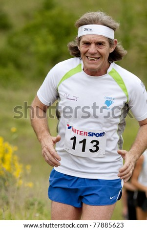 PAVIE, FRANCE - MAY 22: man runner with headband at the Trail of Pavie, on May 22, 2011, in Pavie, France.