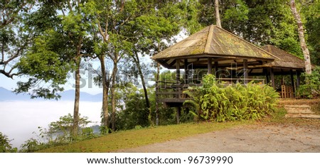 Pavilion and mist on hill side and green nature. at kangkrajan, Thailand.
