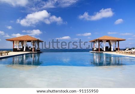 Pavilions and swimming pool near Atlantic Ocean, Dominican Republic