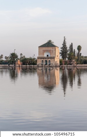 Pavillion reflection on Menara Gardens basin at Marrakech, Morocco