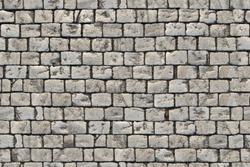 Paving blocks made of small tiles of regular shape, seamless texture