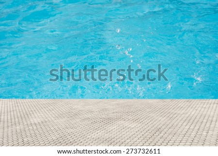 paving brick floor with blue shine water background