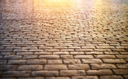 Paving stone vintage road cover. Evening road in a historical place.