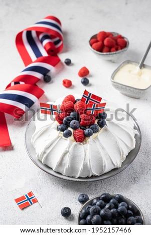 Pavlova cake with strawberries and blueberries and vanilla cream. Norwegian constitutional day. 17th May.  Stock photo ©