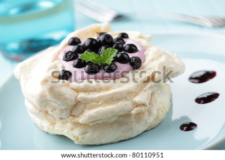 Pavlova dessert, meringue with blueberry and yogurt
