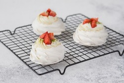 Pavlova with strawberries  and  cream. Cakes made of cane sugar. Tropical cake. Exotic dessert. New Zealand food