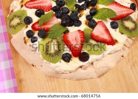 pavlova with strawberry mint blueberry and passion fruit