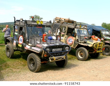 """PAVLOVKA, RUSSIA - JUNE 26: Off-road vehicle UAZ (No. 44) of Team ROTAS takes part at the annual trophy challenge """"23 hours of Nuriman"""" on June 26, 2010 in Pavlovka, Russia."""