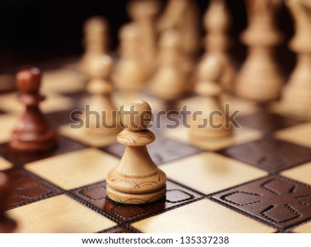 Pawn chess piece on a chessboard
