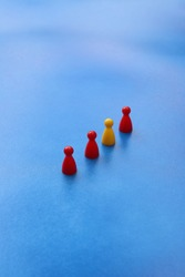 Pawns in a row on blue background.
