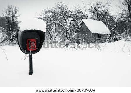 Pay phone in a snow-covered field