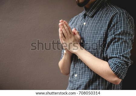 pay respect prayer concept for faith spirituality and religion gray background.