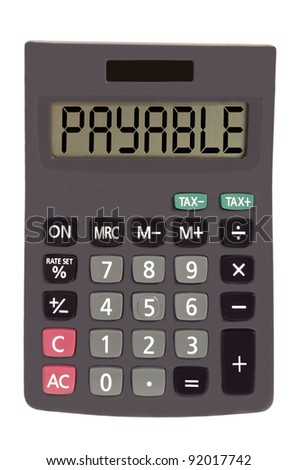 payable on display of an old calculator on white background