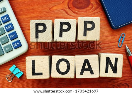 Paycheck Protection Program PPP Loan. Wooden cubes on the desk.