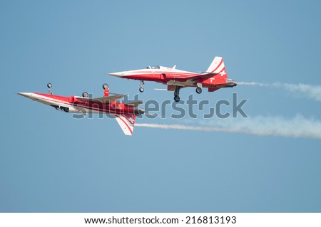 PAYERNE, SWITZERLAND - SEPTEMBER 6: Members of Patrouille Suisse aerobatic team members flying in close distance on AIR14 airshow in Payerne, Switzerland on September 6, 2014