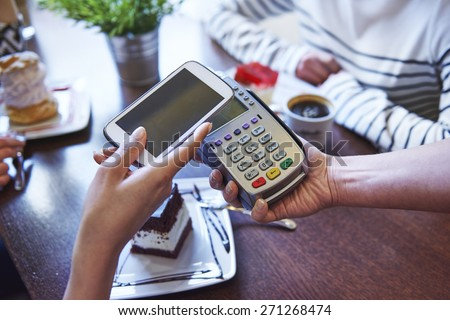 Paying for coffee by mobile phone #271268474