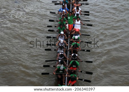 PAYIPPAD, INDIA - SEPT 18: A snake boat team participate in the Payippad Boat race on September 18, 2013 in Payippad, Kerala, India. Boat races are the major sporting events in Kerala.