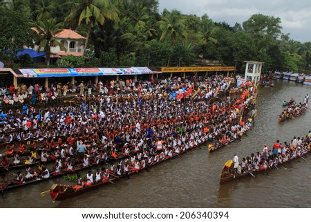 PAYIPPAD, INDIA - SEPT 18:Snake boat teams line up to participate in the Payippad Boat race on September 18, 2013 in Payippad, Kerala, India. Boat races are the major sporting events in Kerala.
