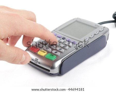 Payment terminal - a finger entering the PIN code