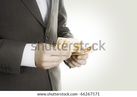 Payoff -Businessman with Money - stock photo