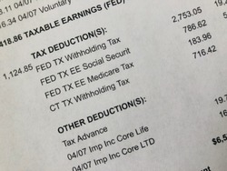 Paystub showing tax deduction detail.