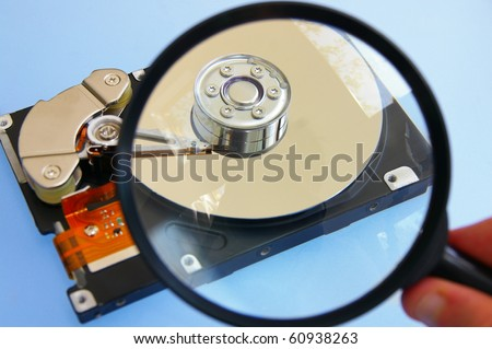 pc hardrive and magnifying glass