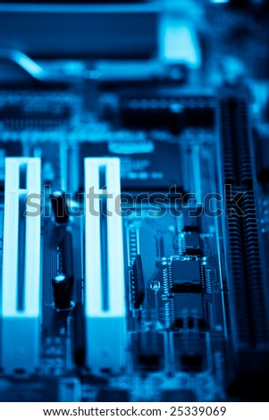 PC motherboard blue toned with shallow depth of field