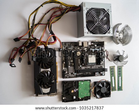 PC repair.PC spare parts. video card, motherboard, RAM, PC cooling system, hard drive, power supply with wires #1035217837