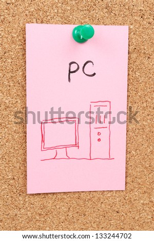 PC word and symbol drawn on paper and pinned on cork board