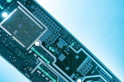 PCB board on a blue background. Blank PCB board close-up. Creation of computer boards. Template for PCB board manufacturing. Microcircuit without copper elements. Design concept microcircuits