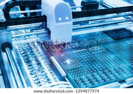 Photo of  PCB Processing on CNC machine,Production of electronic components at high-tech factory