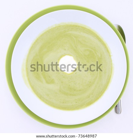 Pea and mozzarella soup decorated with cream