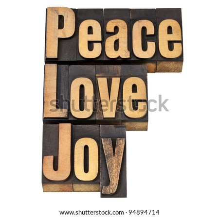 peace, love and joy - isolated words in vintage letterpress wood type