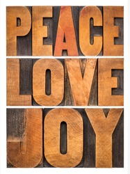 peace, love and joy typography  abstract - a collage of isolated words in letterpress wood type