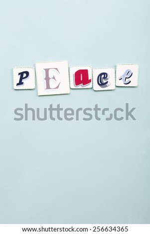 Peace signboard. Handwritten colors letters word. Light blue background. Vertical cut. Calligraphy and lettering fine art.